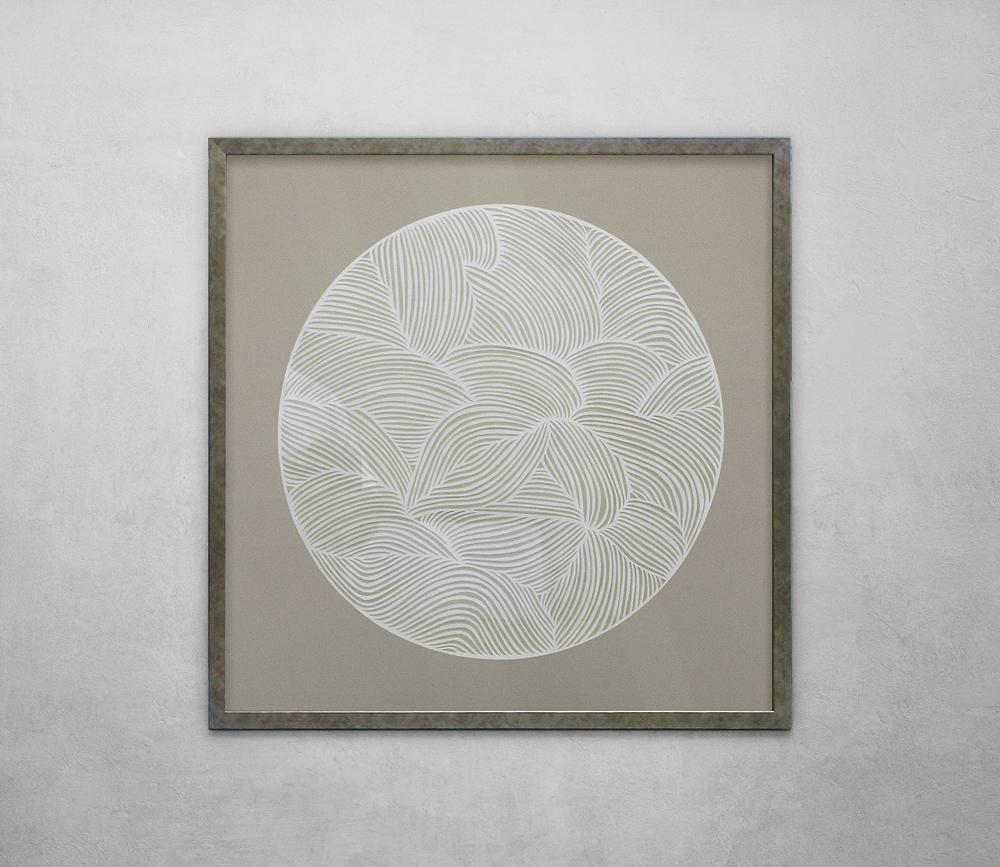 Circular print framed in silver